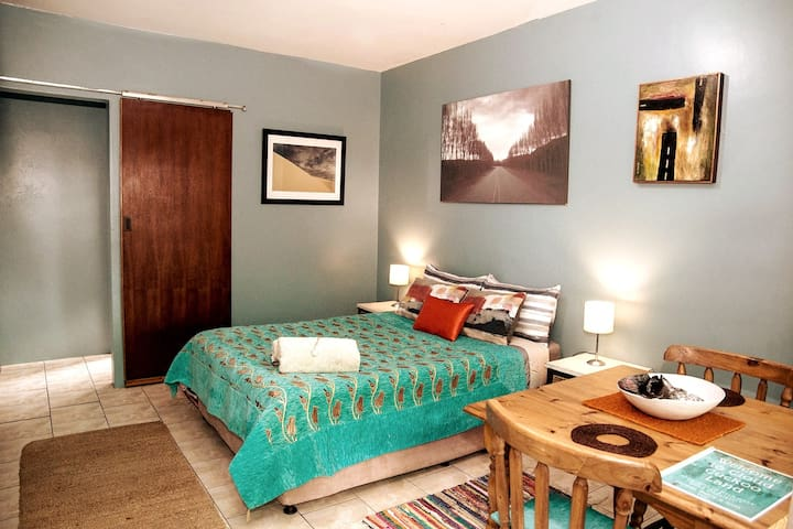 Bedroom with a super comfy double bed. Cool and quiet perfect for a morning sleep in.