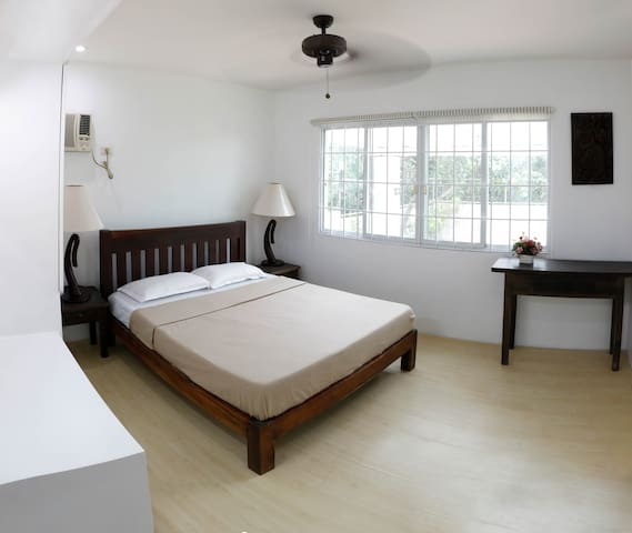 Bedroom 1. Equipped with a Queen sized bed for 2 and an option to add an extra mattress. Comes with ceiling fan to complement the breeze of Tagaytay's fresh air. This room also has air-conditioner.