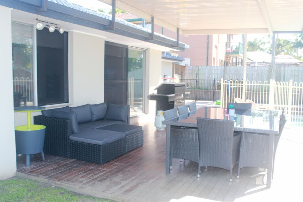 Out door BBQ and Entertaining Area on Back Patio Overlooking Pool