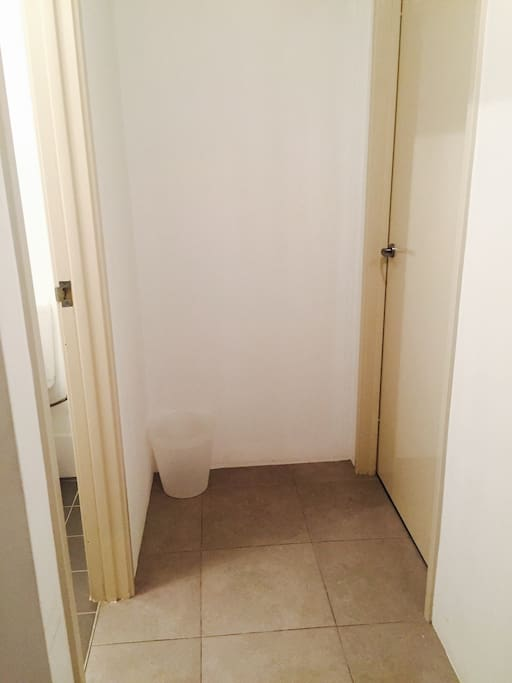 Private toilet on left; bedroom on right