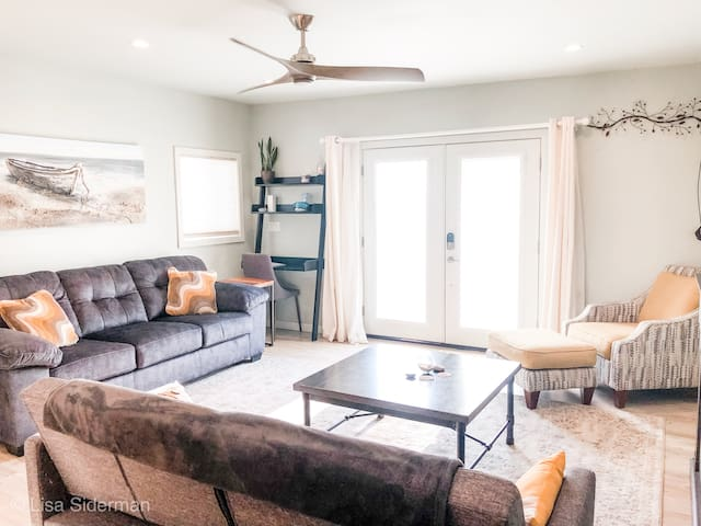 Throw open the living room double doors and bring the outside in!  A  queen sofa-sleeper and a futon for sleeping space, linens in the ottoman.  An electric fireplace and Roku TV round out the stay.  Dining inside for 8 and more seating outside!