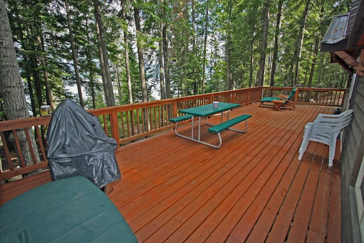 Expansive deck adds living space to cabin.  BBQ, picnic table and chair and still not crowded.