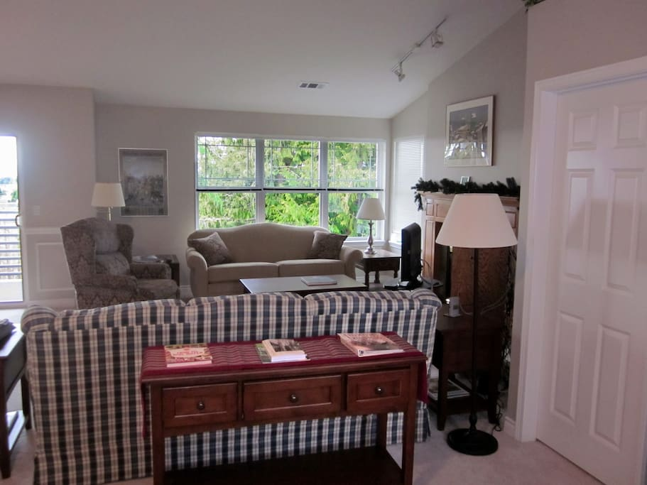 Living room with LCD TV, wireless Internet, two couches and recliner chair and gas fireplace.