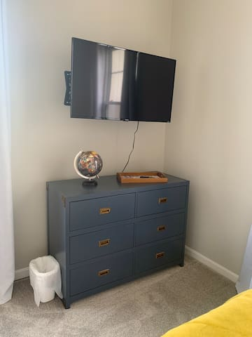 """Plenty of drawer space here! You can also enjoy TV in bed with this 43"""" Roku TV."""