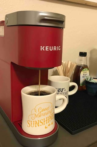 Mini Keurig makes a great 10 or 12 oz cup of coffee. Remove the tray and fill your travel mug for the road.