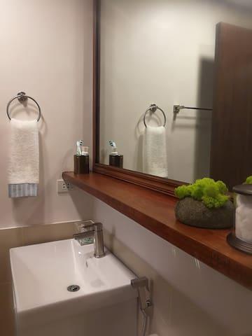 An oversized bathroom mirror