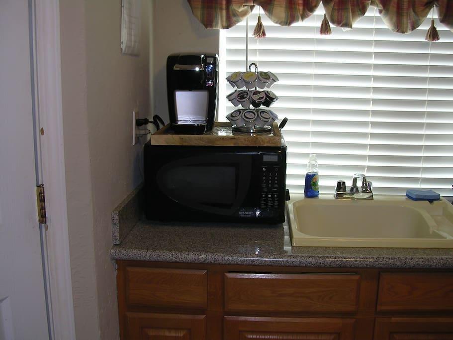 Kuerig coffee maker, microwave, deep kitchen sink