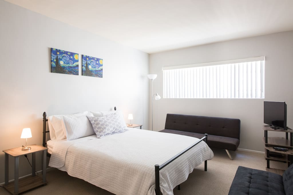 Enjoy natural lighting and the chic décor of our master bedroom. There's both a queen sized bed and a futon.