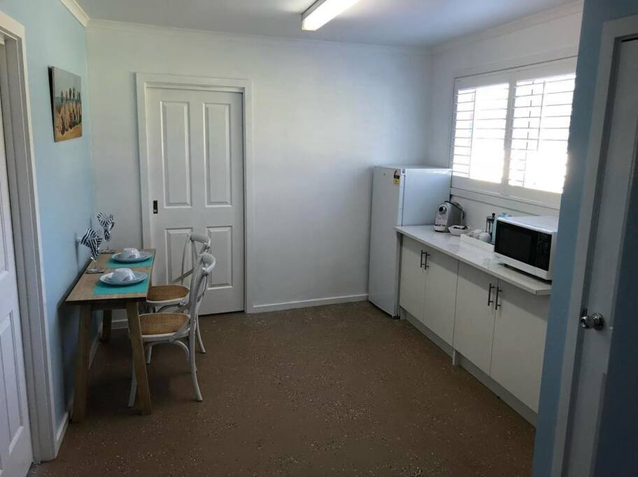Kitchenette with coffee machine, fridge, freezer and microwave