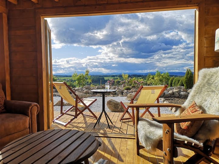 Luxury self-catering log cabin at Assich Zen Lodge