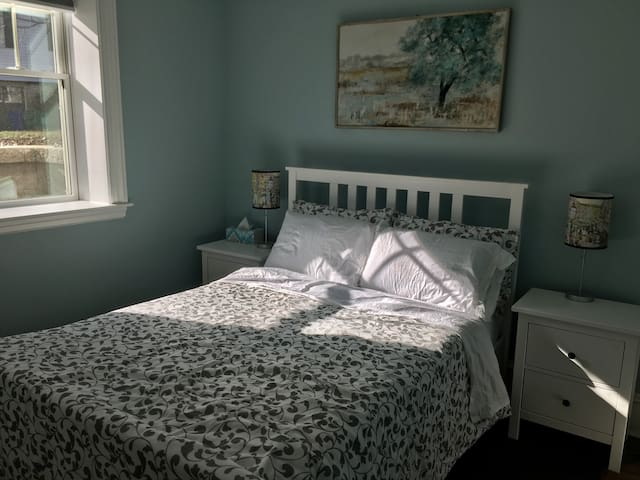 Cozy bedroom with full-size bed and Leesa mattress.