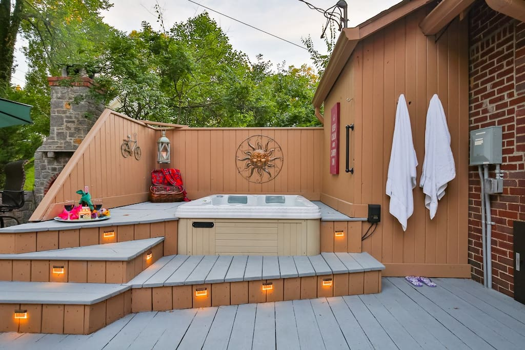 Sink into the built-in hot tub day or night