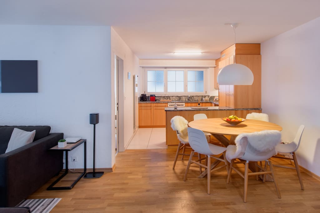 The kitchen with its marble work surface is spacious and open plan, with everything you might need – dishwasher, oven, hob, fridge-freezer, Nespresso machine.