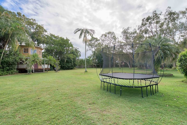 Large fully fenced play area for kids and pets