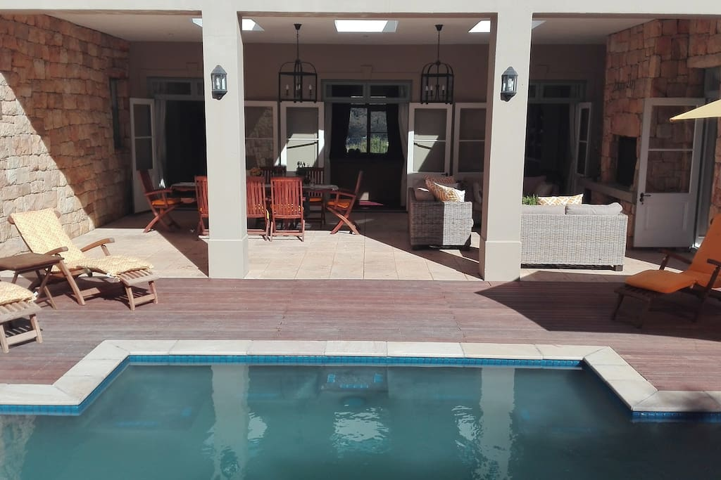 Solar heated pool with wooden deck