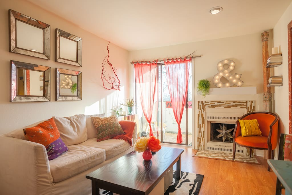 South facing light pours into this colorful and inviting living room!