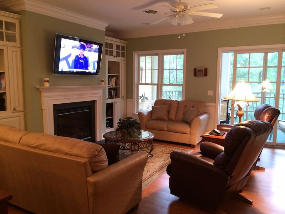 Living Area with french doors leading to screen porch