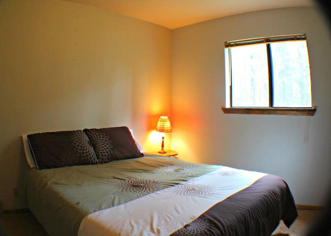 Morgan's Room (bdrm 4 ds)  also has a queen bed. Relaxing room with a forest view