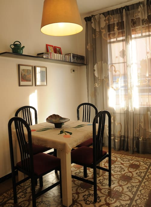 Dining room with original tile and balcony