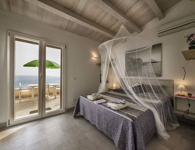 Romantic bedroom with direct stunning view over the sea