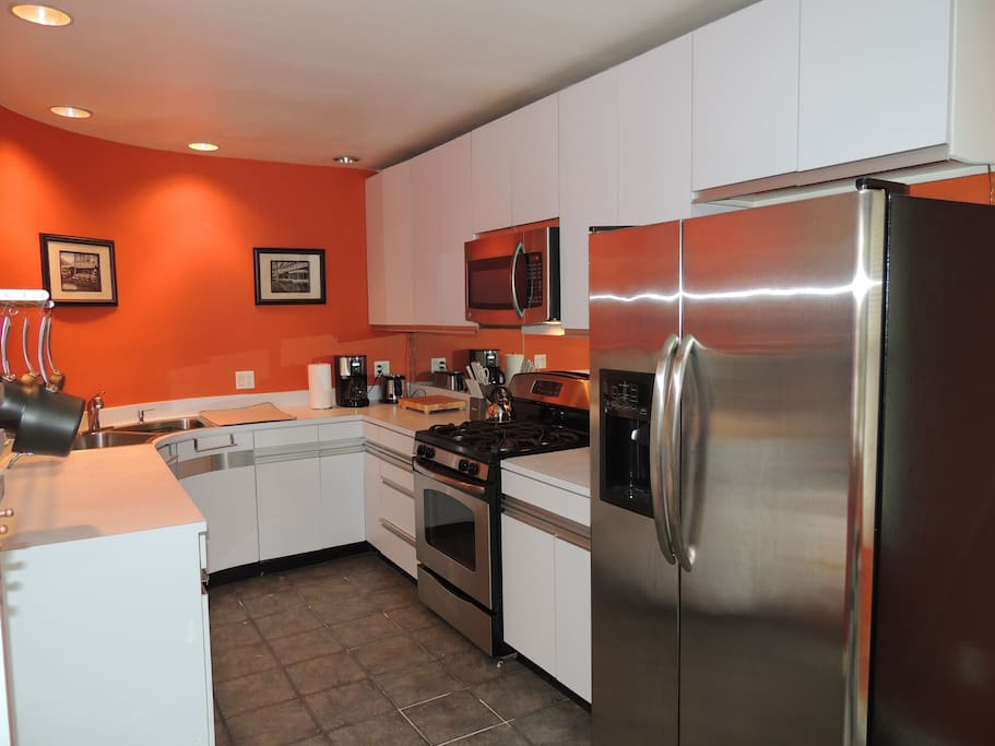 Kitchen with updated stainless steel refrigerator and gas stove