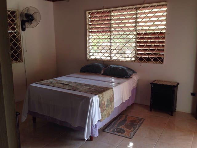 Large bedroom with ensuite and large closet lots of storage and place to hang your clothes.