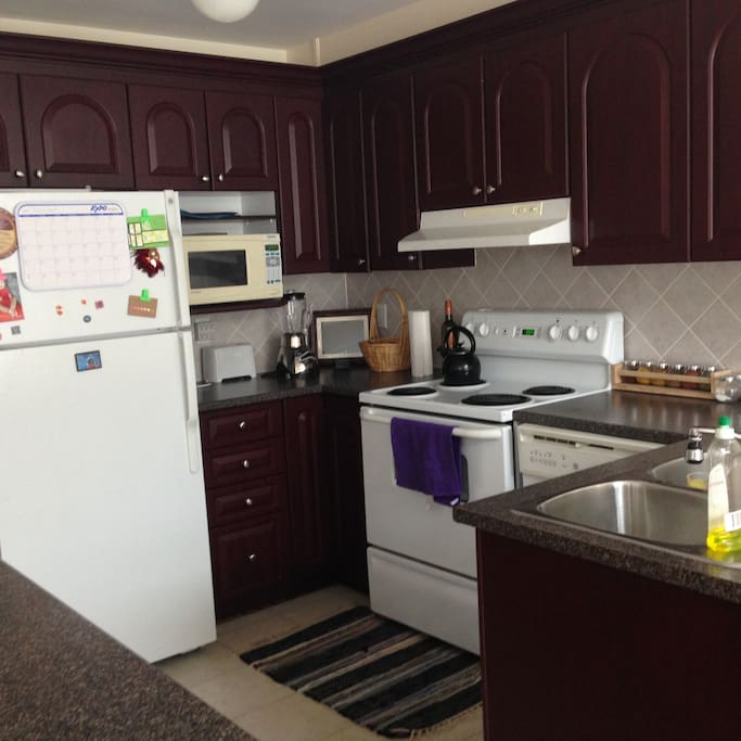 Shared kitchen space - includes utensils, plates/cups/bowls, pots and pans
