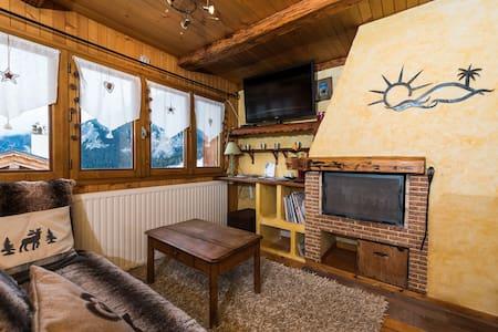 appartement cosy ski aux pieds - Courchevel village  - Almhütte