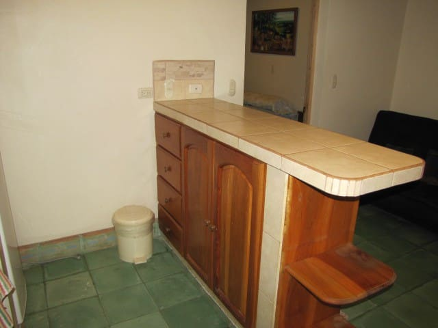 Kitchen counter and prep area with drawers and cabinet space