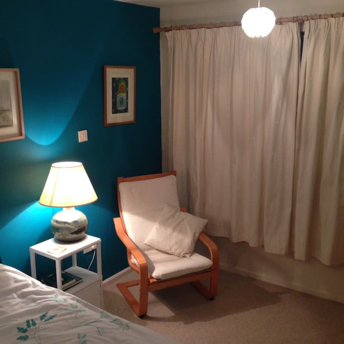Teal room with comfy chair
