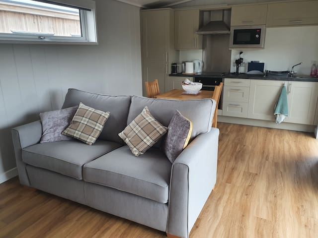 Open plan sitting/kitchen/dining