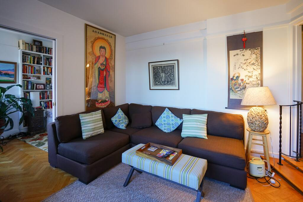 The Buddha shares space on our walls with a pair of hippies and an ancient Chinese scroll!