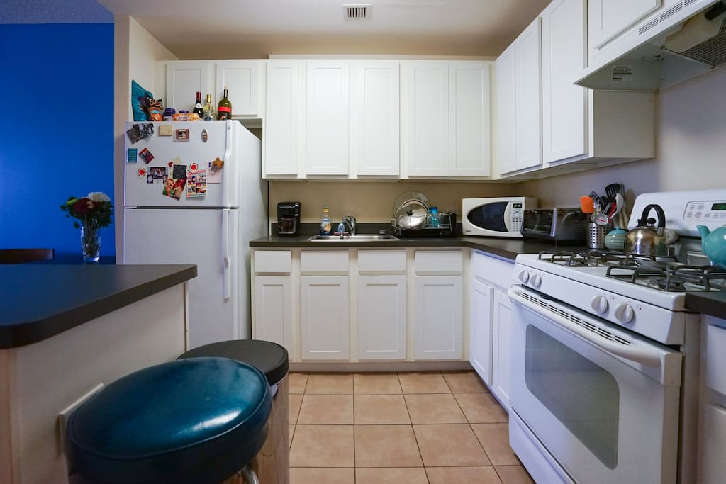 full size kitchen with island, microwave, toaster oven, keurig coffee machine (complimentary coffee)
