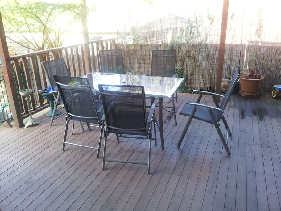 Covered deck for relaxing and dining.  Top filters 90% of the UV