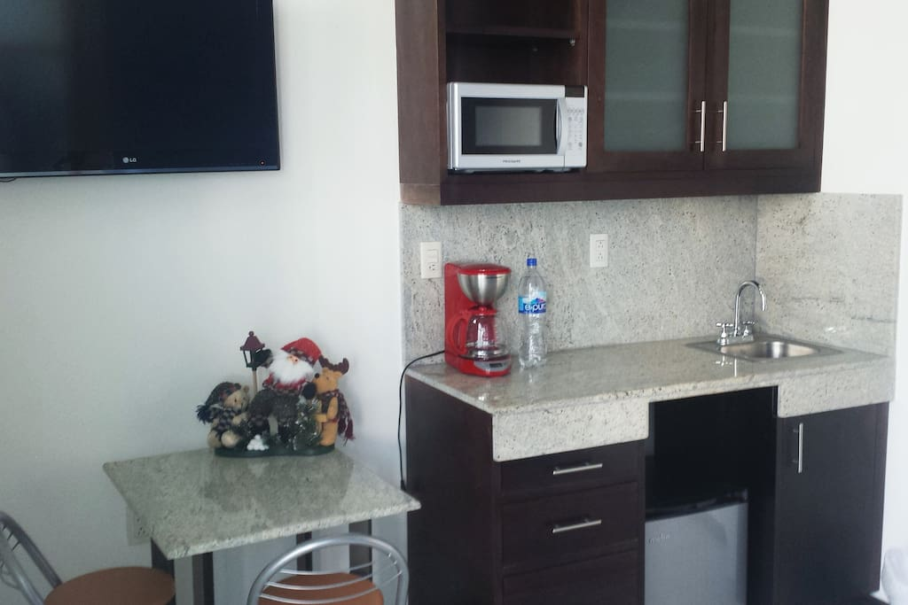 Kitchen includes a small table, satellite tv, microwave, coffe maker, plateware and mini bar. (Each loft has its own)
