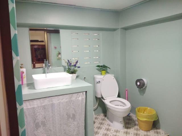 Clean private bathroom with hot shower, full bathroom amenities.