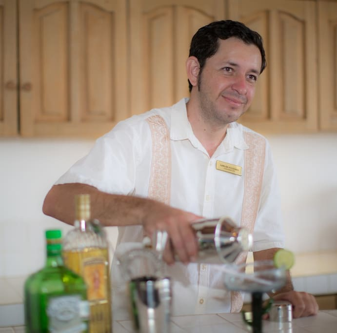 Carlos, your personal bartender, mixing drinks