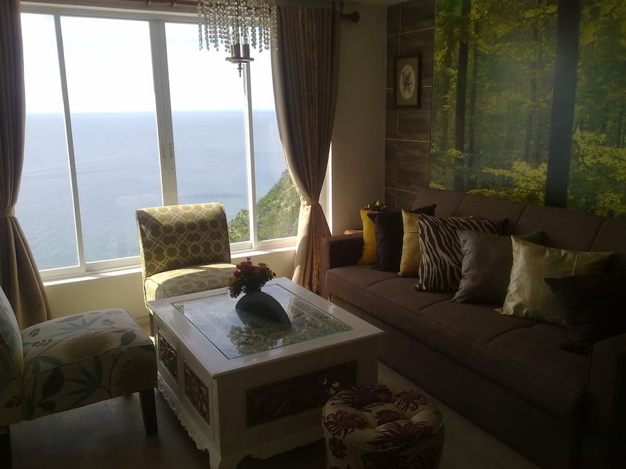 Living room overlooking the sea with a pullout sofa bed as additional sleeping place.