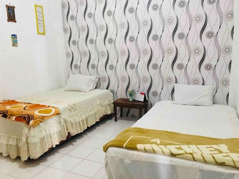 Two beds in a room in Tomohon