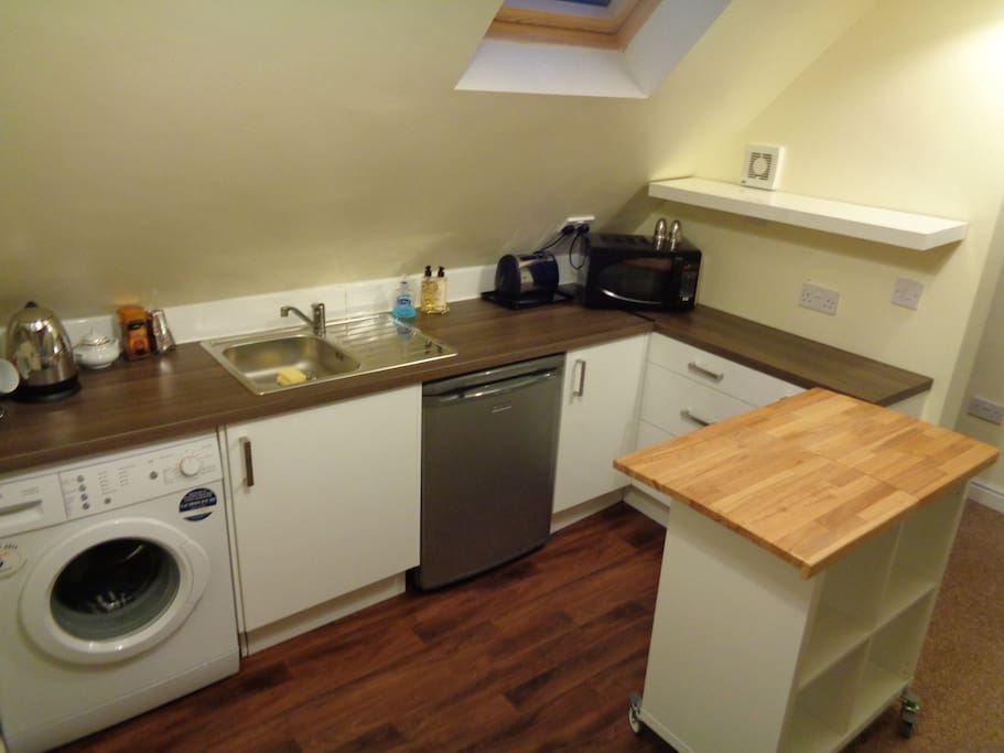 Kitchen with  Sink, Fridge, Microwave and washing machine