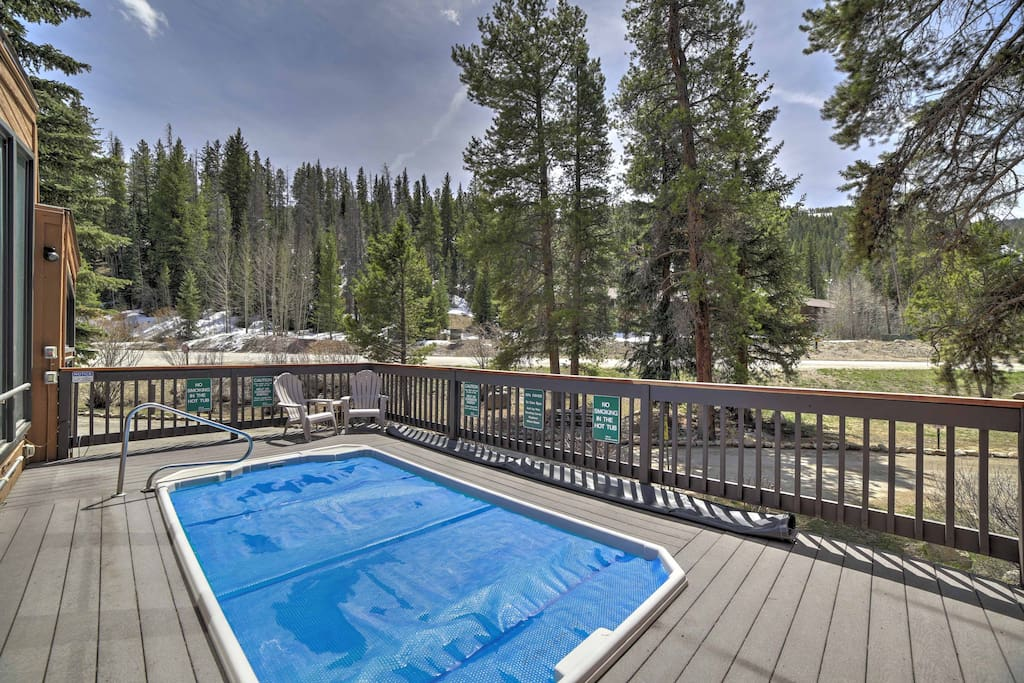 Enjoy majestic mountain views from the hot tub when you stay at this incredible vacation rental condo in Keystone.