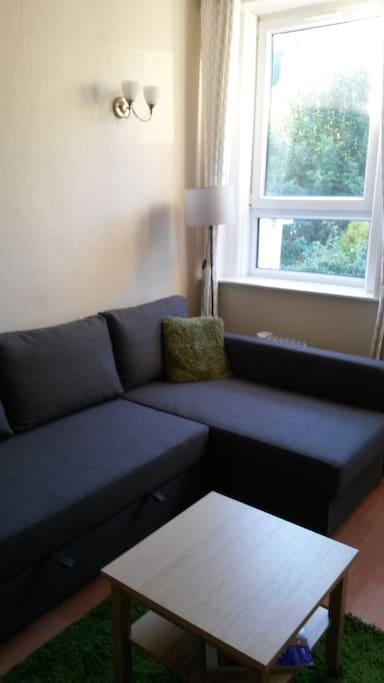 Corner sofa which converts to a King-Sized bed.  Please book for 3 people if you wish this second bed to be made up.
