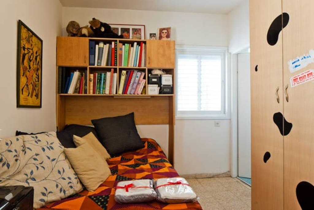 This is your cool room with a cabinet and a desk.