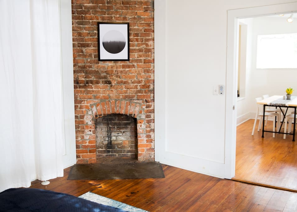 Decorative fireplace in master- one of The Yellow Door's many charming details.