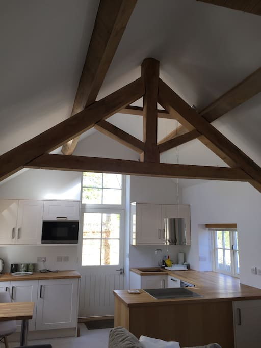 Fully equipped kitchen with feature oak truss