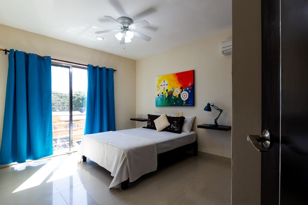 The first bedroom with a balcony - spacious and bright.