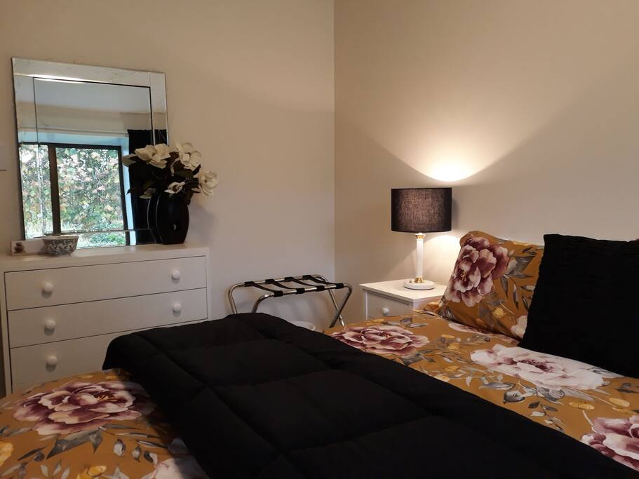 Wardrobe, side tables , dresser , luggage rack and chair all provided.
