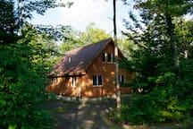 MOTTLED SHADE - The cabin is nestled into the Maine wilderness. There are no neighbors except some seasonal camps across the river and one a quarter mile up the road.