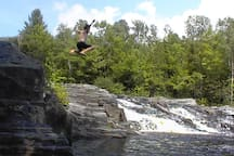 LEDGE JUMPING - Across the river from our cabin is this favorite swimming hole, with slate outcroppings for jumping into the water. The pool is about 50-feet around and 10-feet deep at the center. Diving is not recommended. Parental supervision is recomme