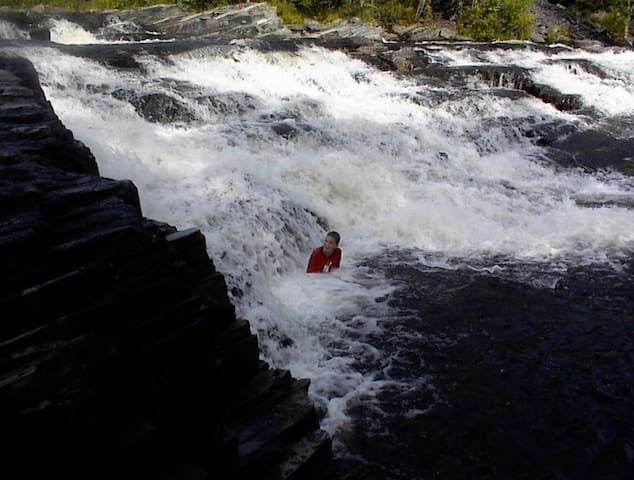 NATURAL JACUZZI - A young swimmer lets Big Wilson Falls give him a natural massage.